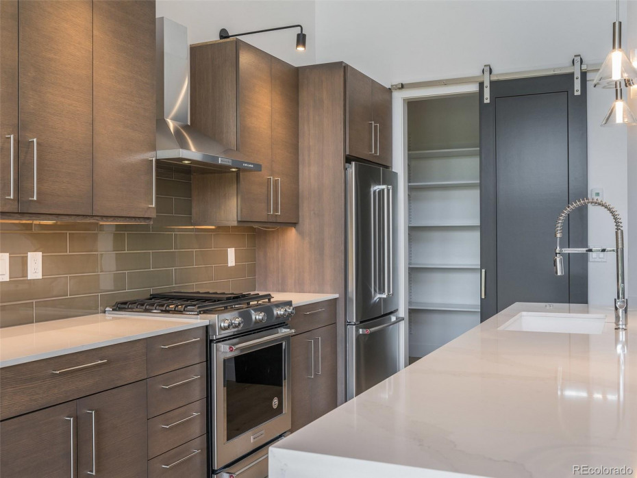 Mountain Eclectic finishes w/base appliances in Unit T2 (middle unit, sold)