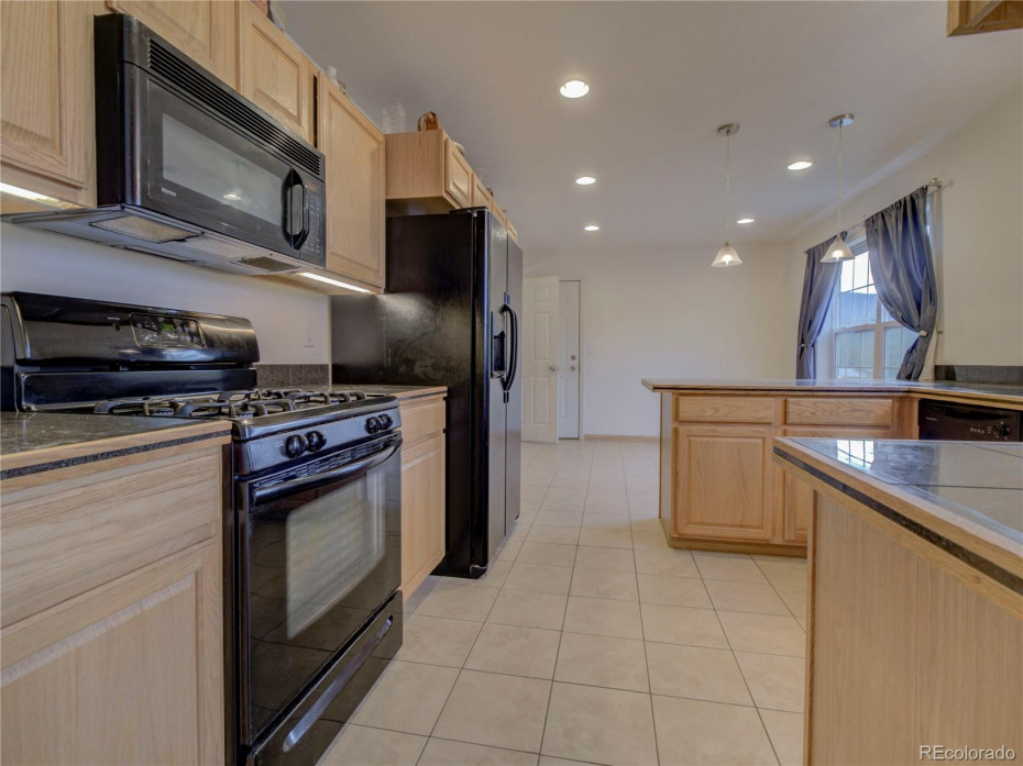 Kitchen with granite counters and gas stove