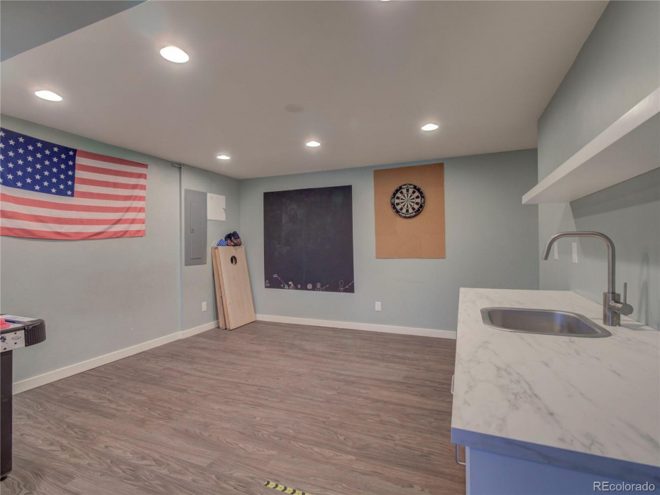 Lower level game room space with wet bar