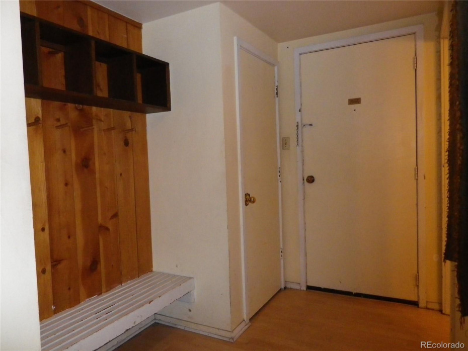 Entry, with storage closet, and area to sit and remove shoes and store gear