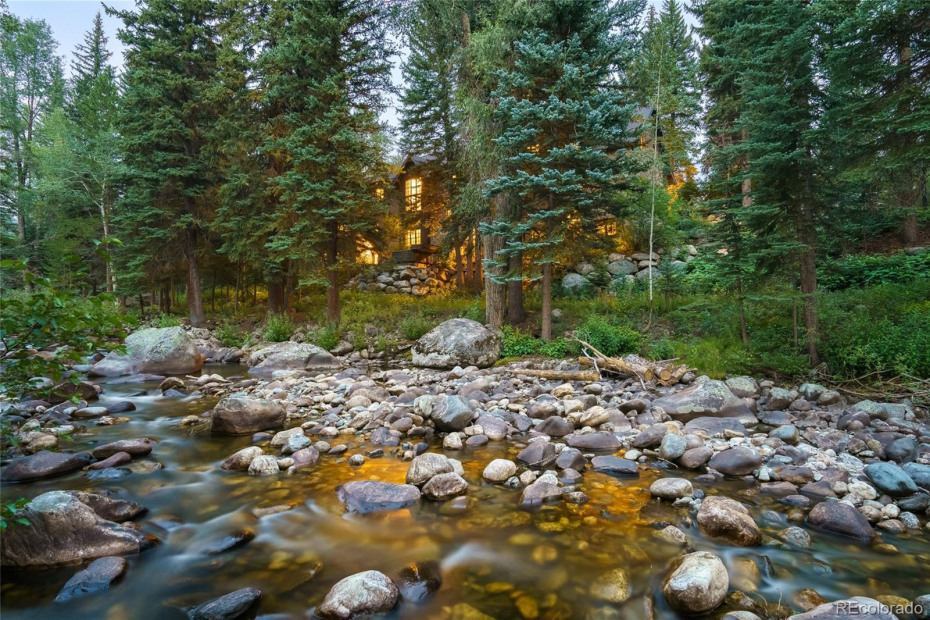 Surrounded by tall pines above the banks of Fish Creek