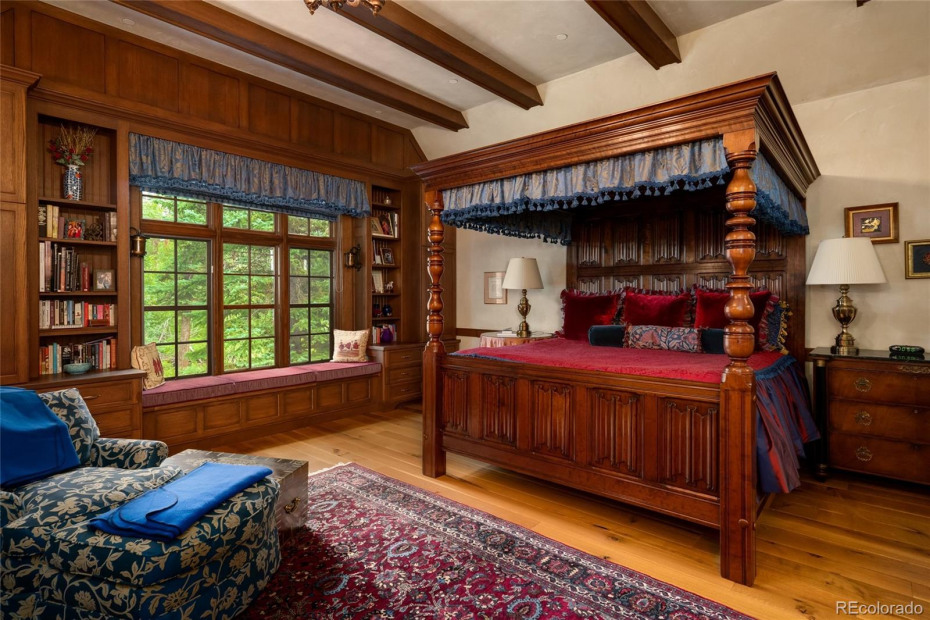 Master suite with fireplace, spacious bathroom, and sitting area