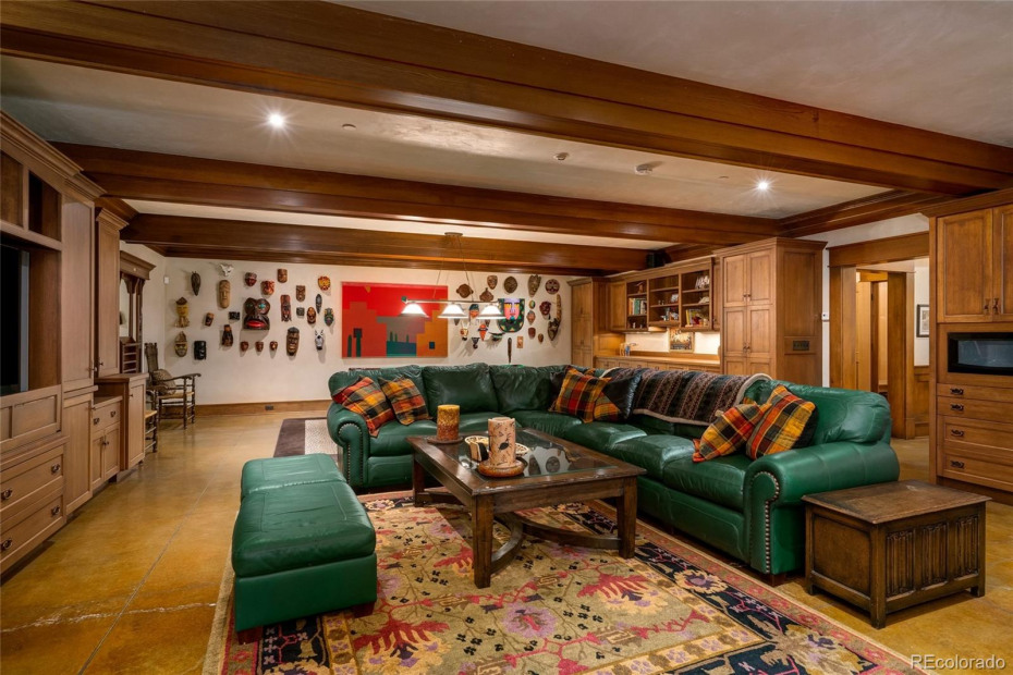 Spacious living area with wet bar and fireplace