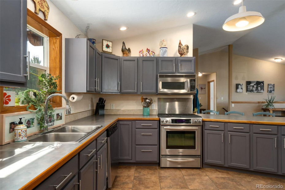 Spacious open kitchen with plenty of cabinet space, pantry and bar seating