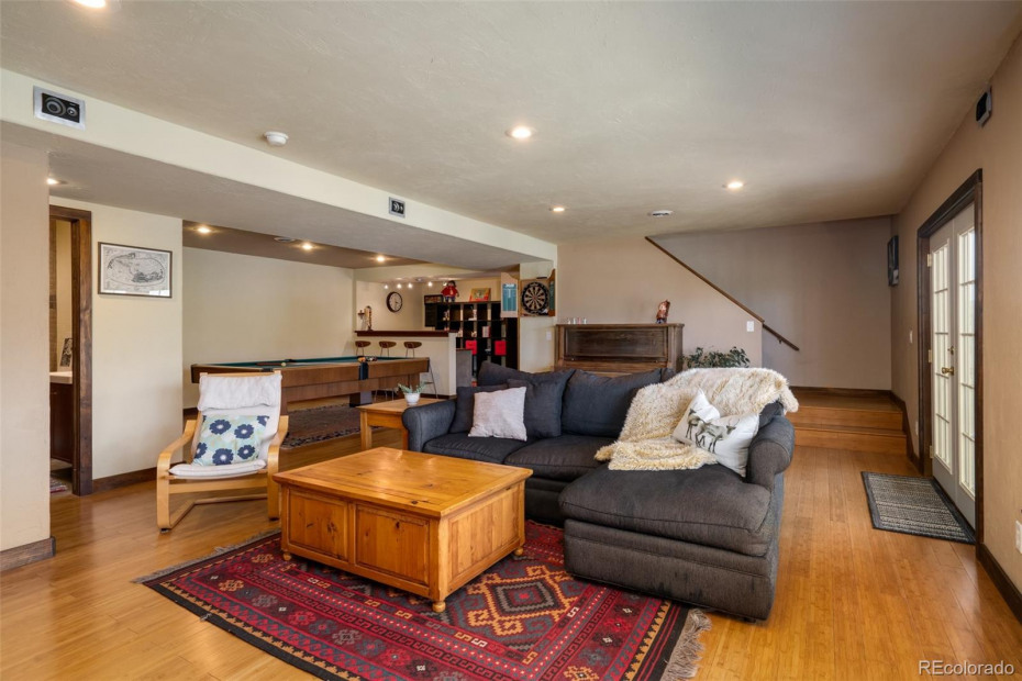 Large family room with room for pool, piano, watching a ball game and bar