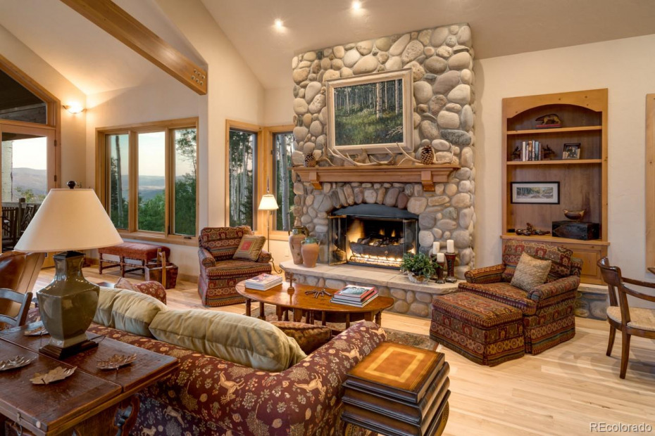 Cozy den with stone fireplace