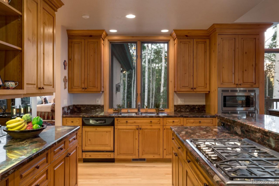Kitchen with granite counter-tops and island