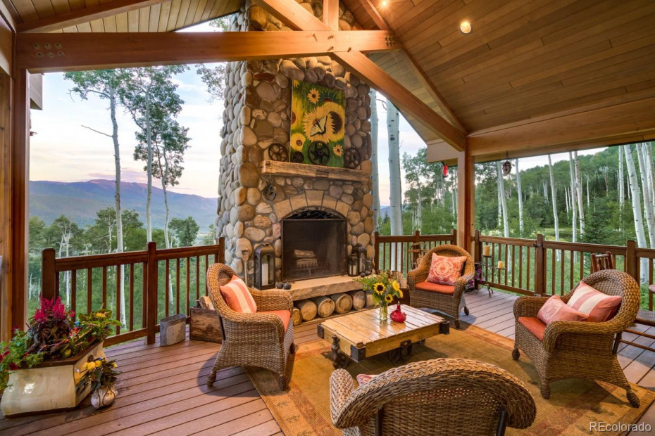 Covered outdoor porch with fireplace and breathtaking views