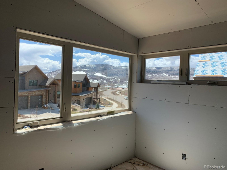 View from the master bedroom on upper level looking down Sunlight Drive