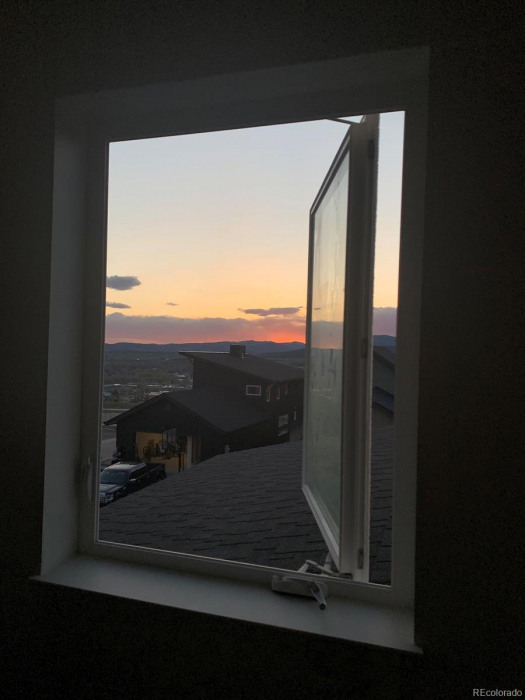 Sunset view out Bedroom 3 from inside the room.