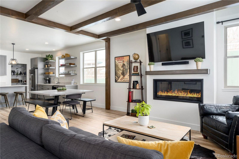 """MODEL HOME w/ Timber upgrade package, 48"""" upgrade fireplace w/ steel mantel, LVP Flooring."""