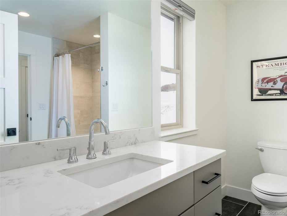 MODEL HOME Bathroom upper level - Upgraded quartz counter-tops, upgrade painted cabinets (Dovetail)