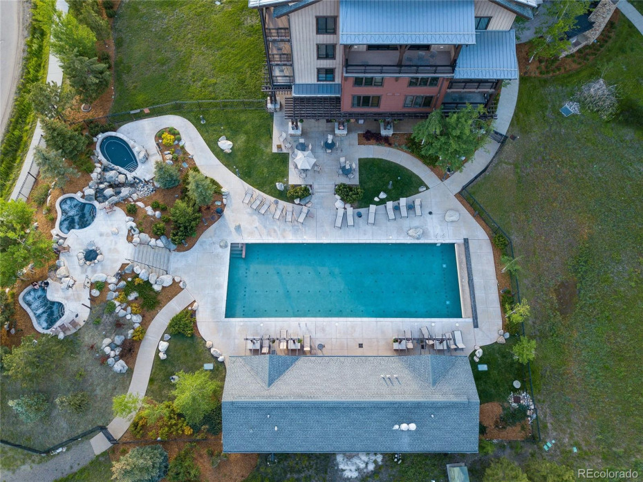 Pool complex includes heated pool, hot tubs, pool deck and grill area