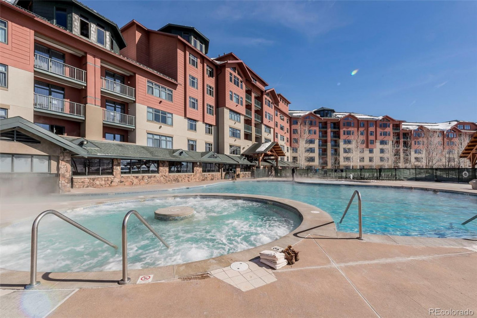 Very popular outside heated swimming pool and one of the two hot tubs at the Steamboat Grand.