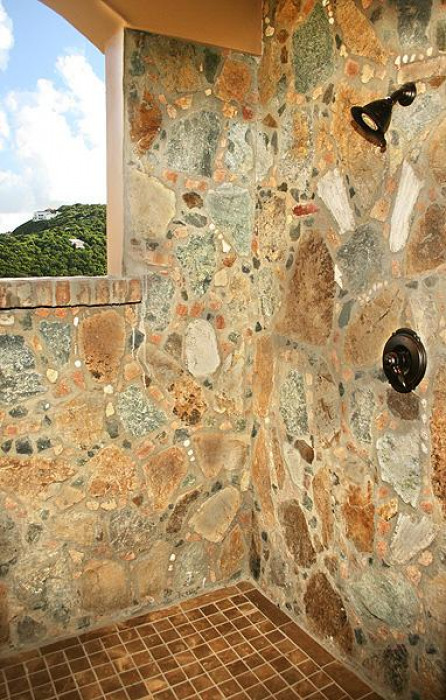 Island stone showers in guest bathrooms