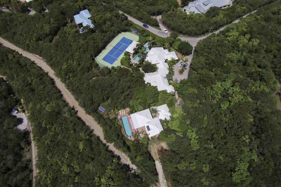 Cottage and lap pool in foreground