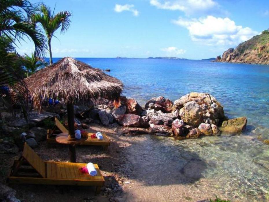 Pocket beach with palapa and chaise loun