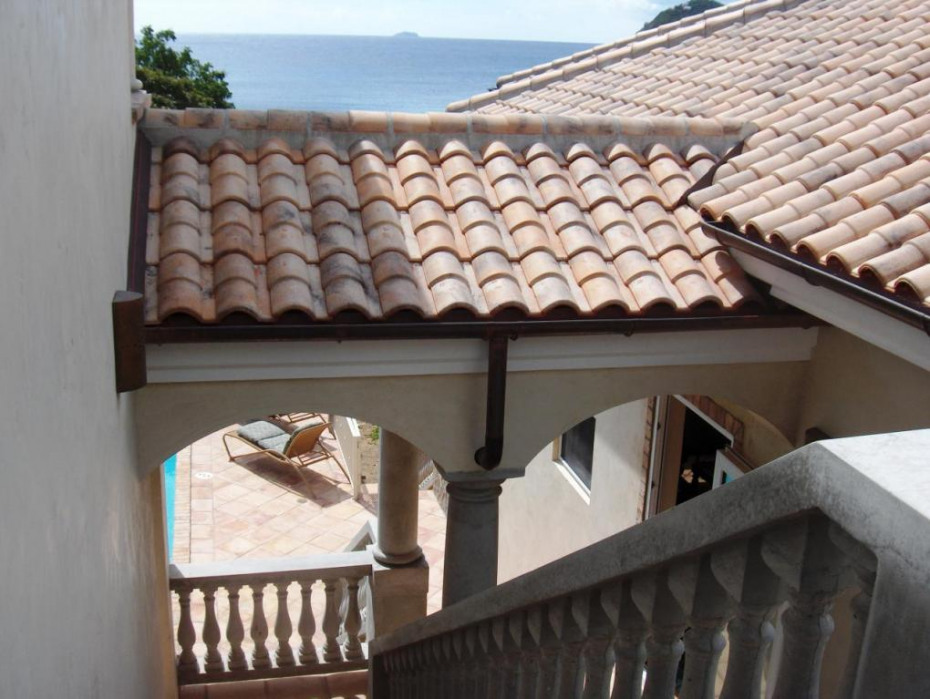 French clay tile roof, copper gutters