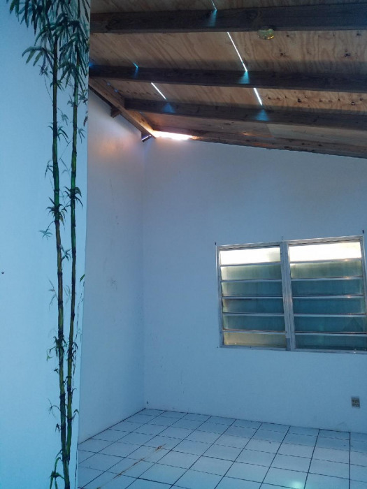 Upstairs Bedroom with roof damage
