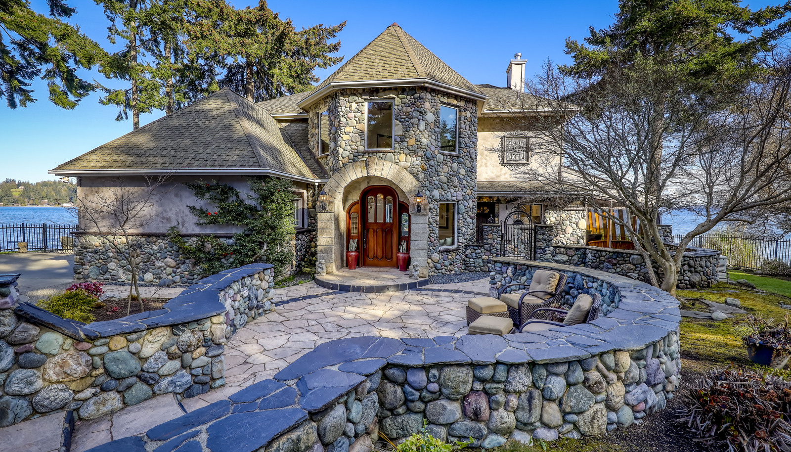 Exquisite real river rock and natural stone walls, patios, pathways, and siding.