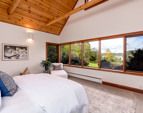 The Master Suite, part of its own wing. Also offers French doors doors to its own private deck.