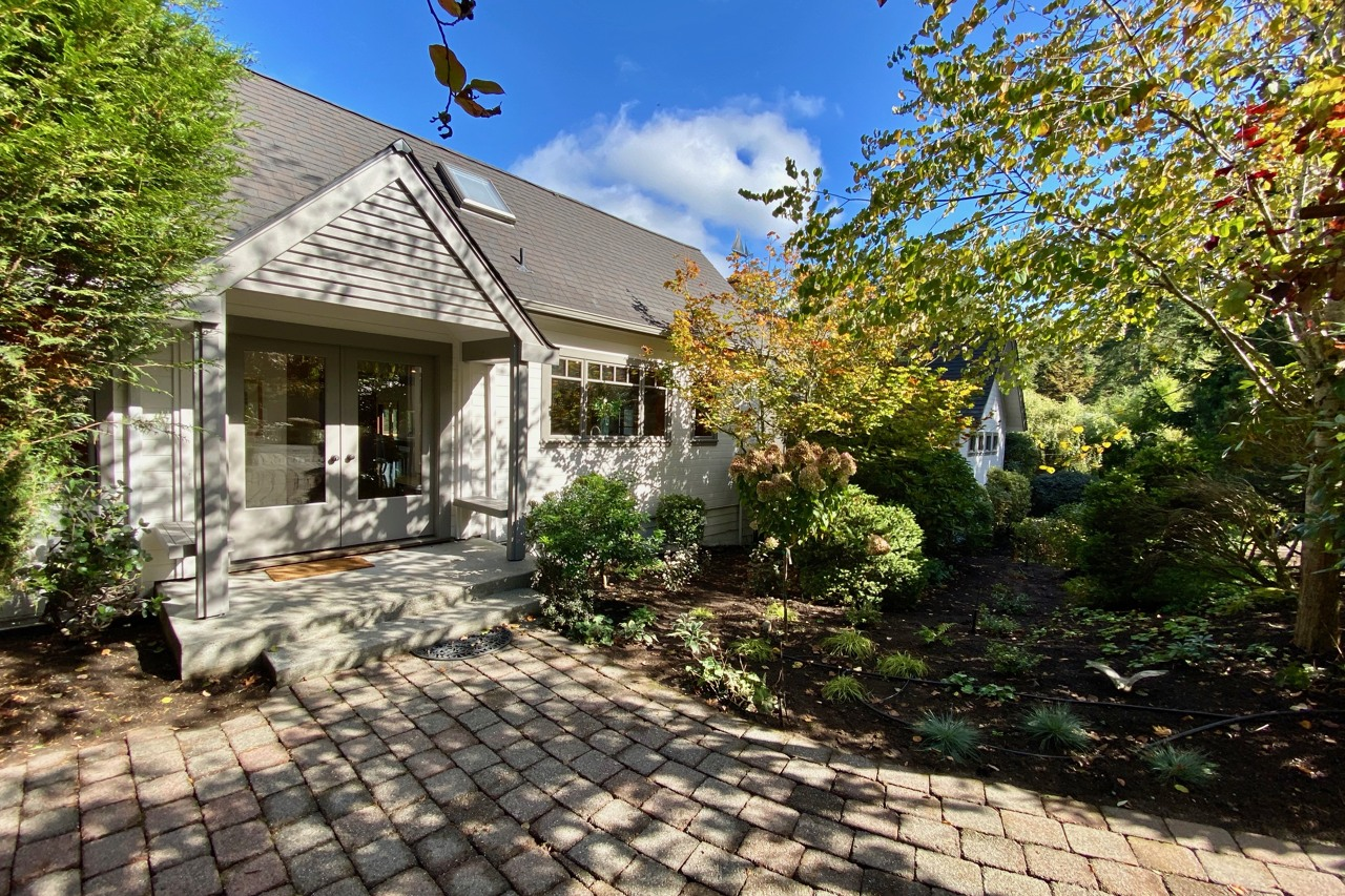 Paleo stones lead through the gardens to the original entrance of the home. New roof and all new exterior paint!
