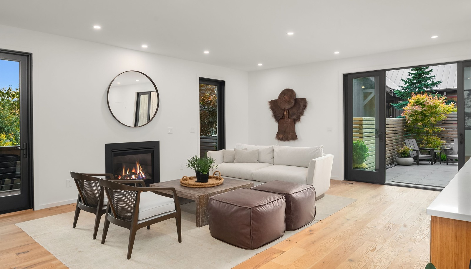 Main level family room w/ wet bar and sublime courtyard access!