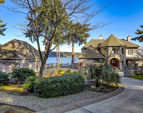 Circular drive, gorgeous landscaping, and water views in all directions!