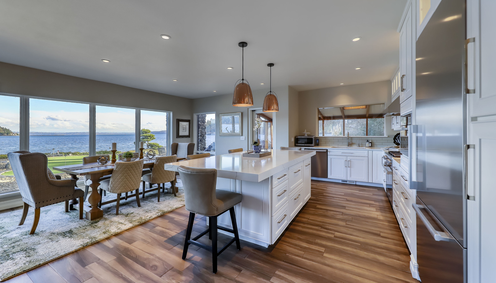 Beautifully updated kitchen with quartz counters, tons of storage, and a full suite of Miele appliances!