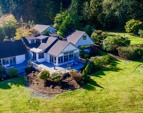 2.89 acres of lawns, gardens, a sports court, pond and forest.