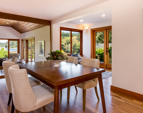 Dining room to living room with French doors to the deck on the left.