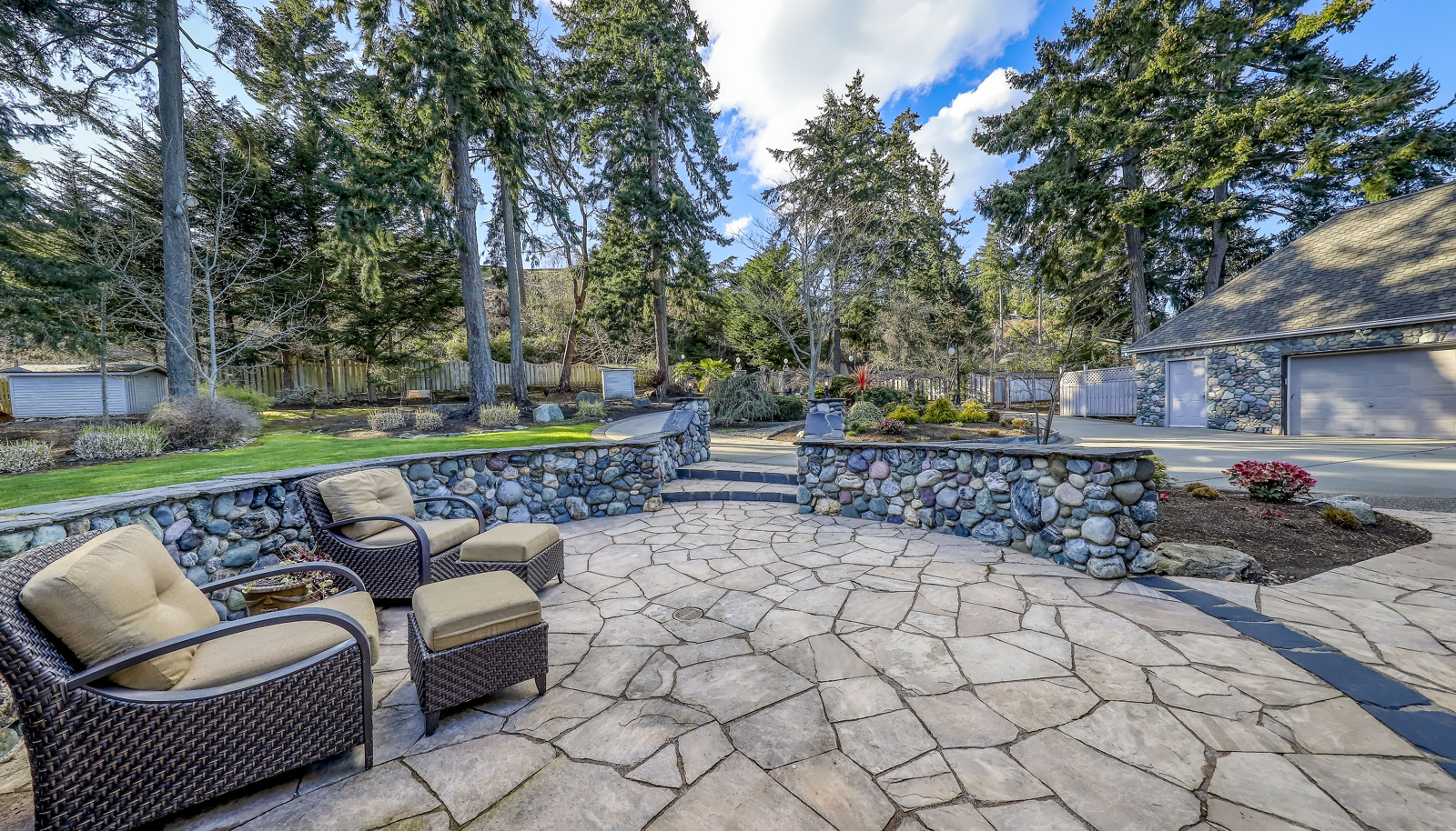 Beautiful shot looking back at the gated and fully fenced front yard.. notice the privacy and usability this property has to off