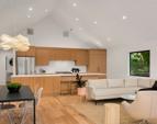 Custom white rift oak kitchen cabinets.