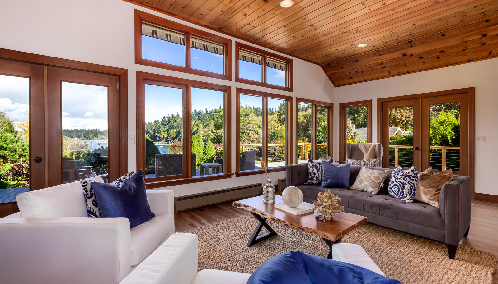Two sets of French doors access the deck and all windows swing open!
