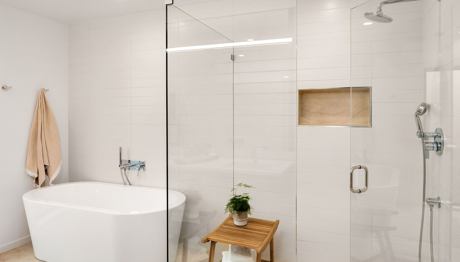 Floor to ceiling tile, soaking tub, curbless walk-in-shower.
