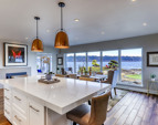 View from the kitchen towards the dining area and the stunning views.