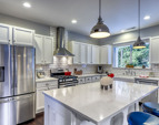 Gorgeous Quartz counters, huge eat-in-island, tile backsplash, newer S/S appliances!