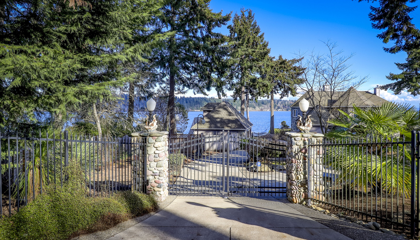 End of the road privacy and peace and quiet on legendary Watauga Beach Drive...gated and fully fenced entry.