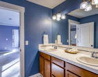 Luxurious master bath with dual sinks, gigantic soaking tub, and walk-in shower.