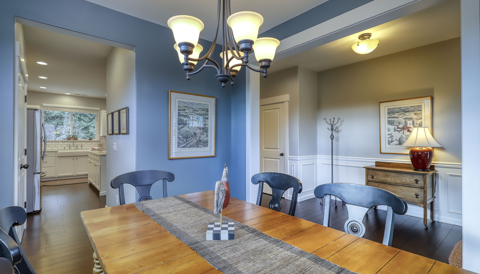 Formal dining room with easy access to the Chef's gourmet updated kitchen!