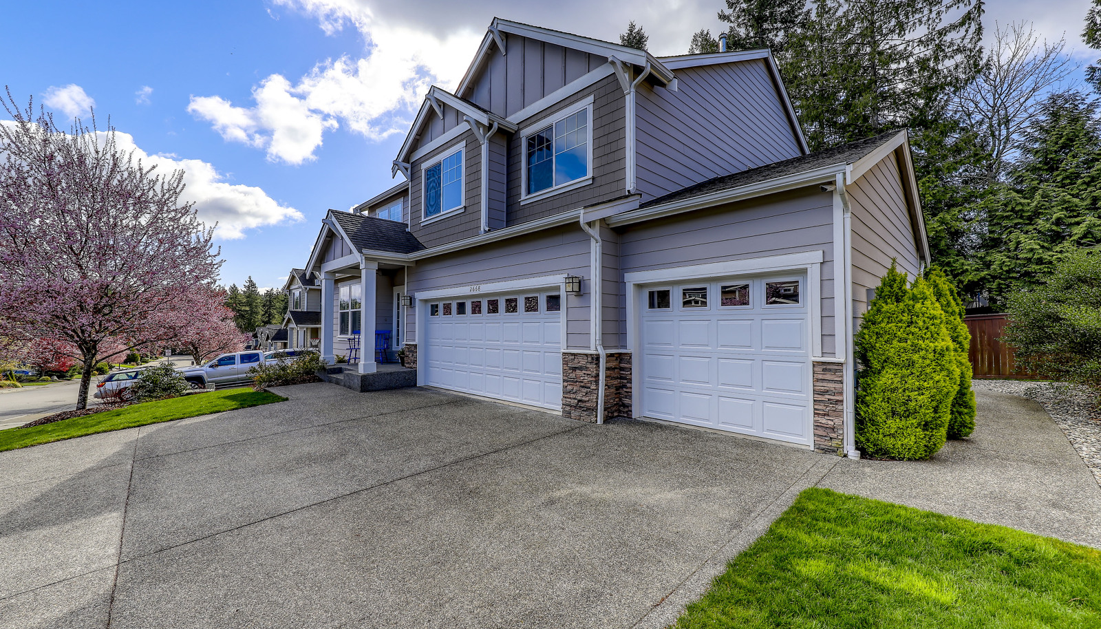 HUGE concrete driveway and 3 car garage with EV Charger!