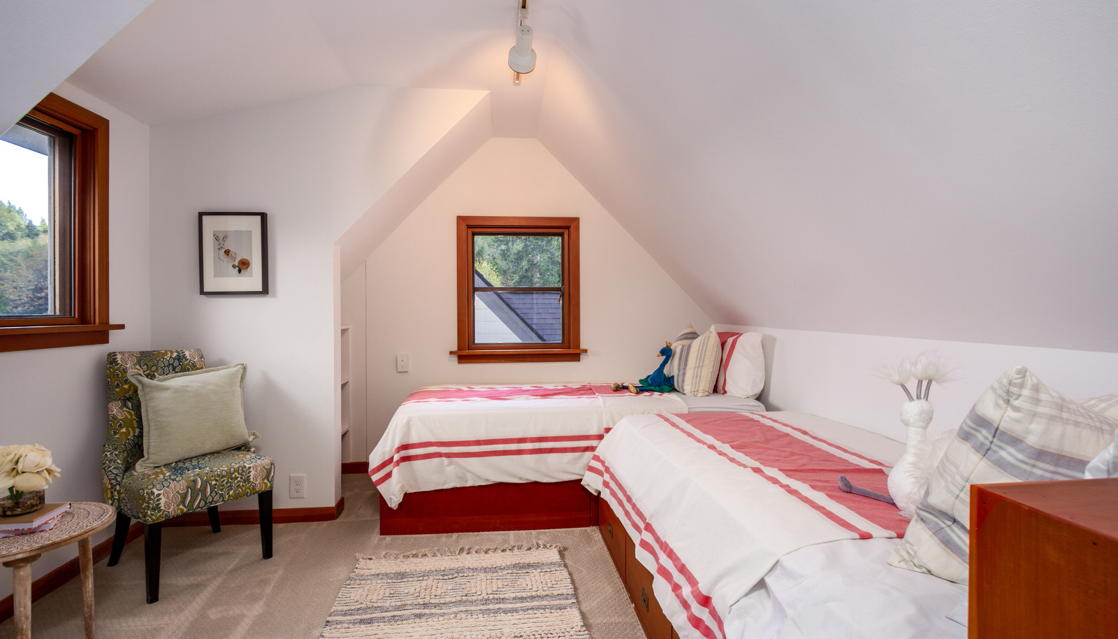 One of two upstairs bedrooms, served by a full bathroom.