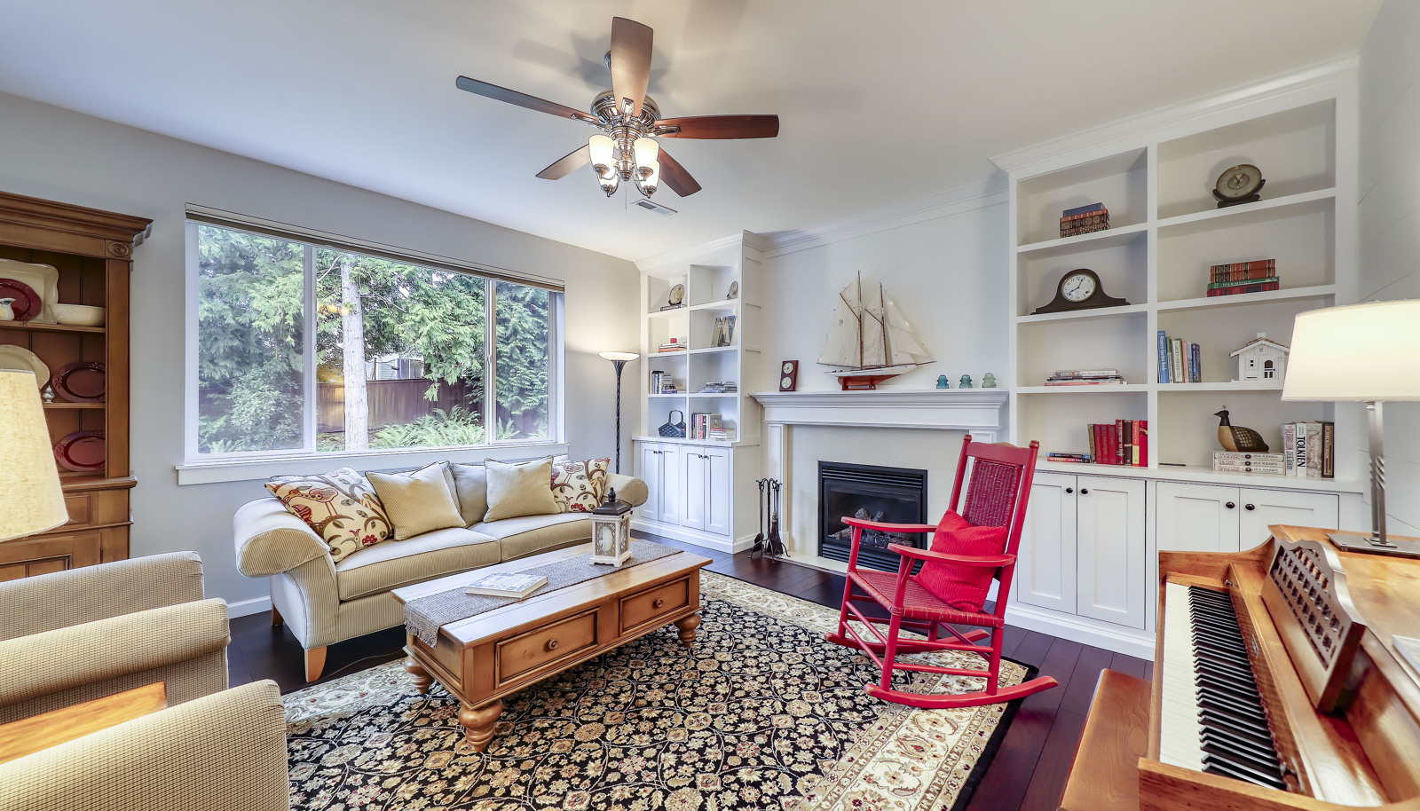 Gorgeous living room with wall of built-ins and gas fireplace holding center court.